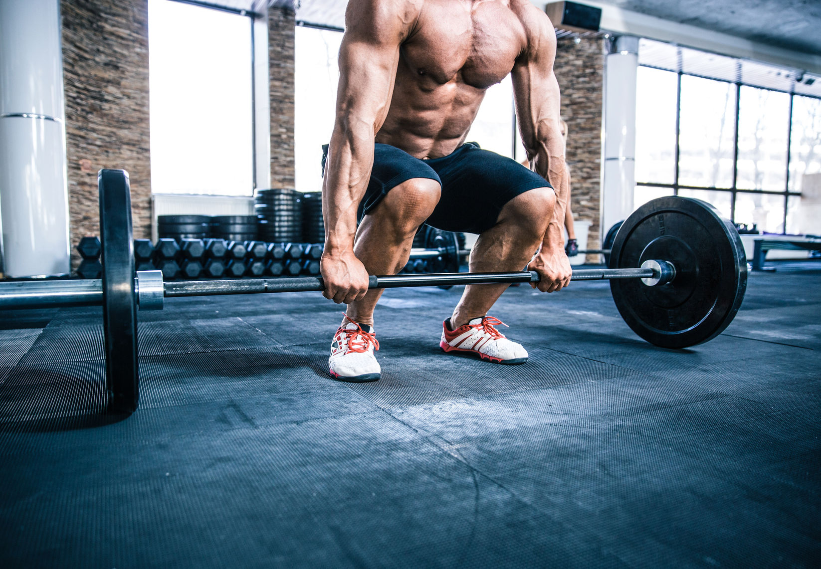 38794415 - closeup portrait of a muscular man workout with barbell at gym